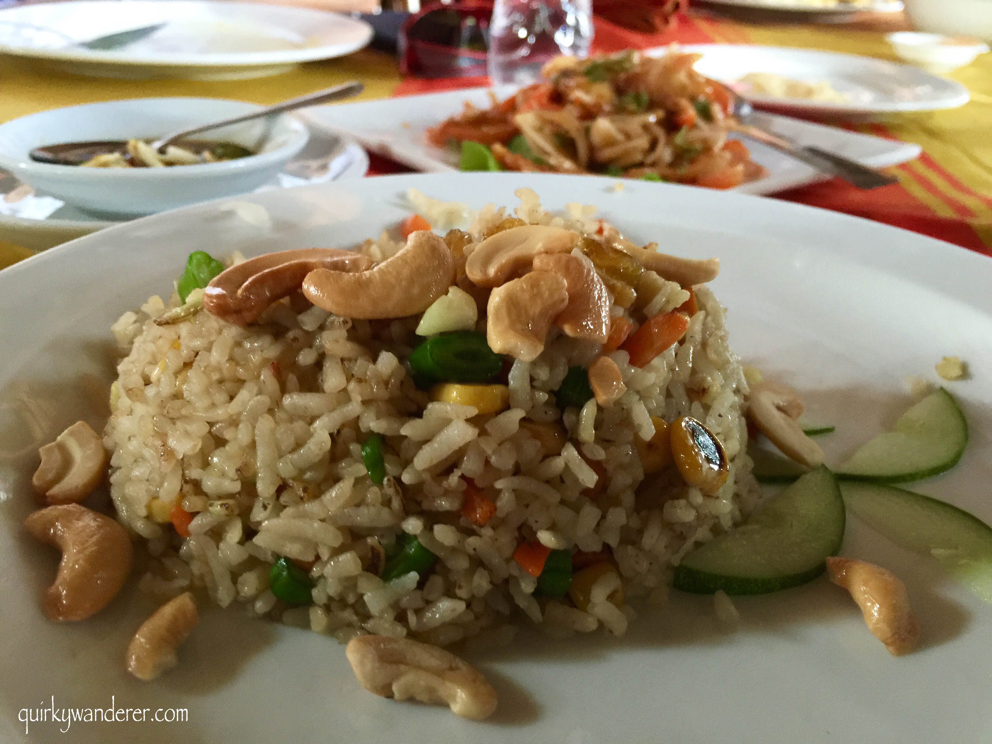Vegetarian fried rice garnished with cashews and cucumber
