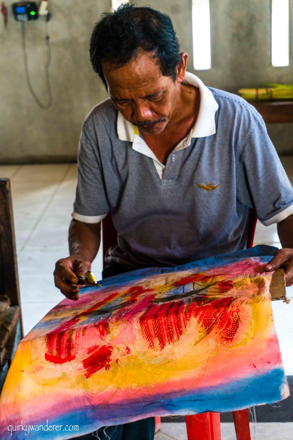 Batik painter in Batu Bulan