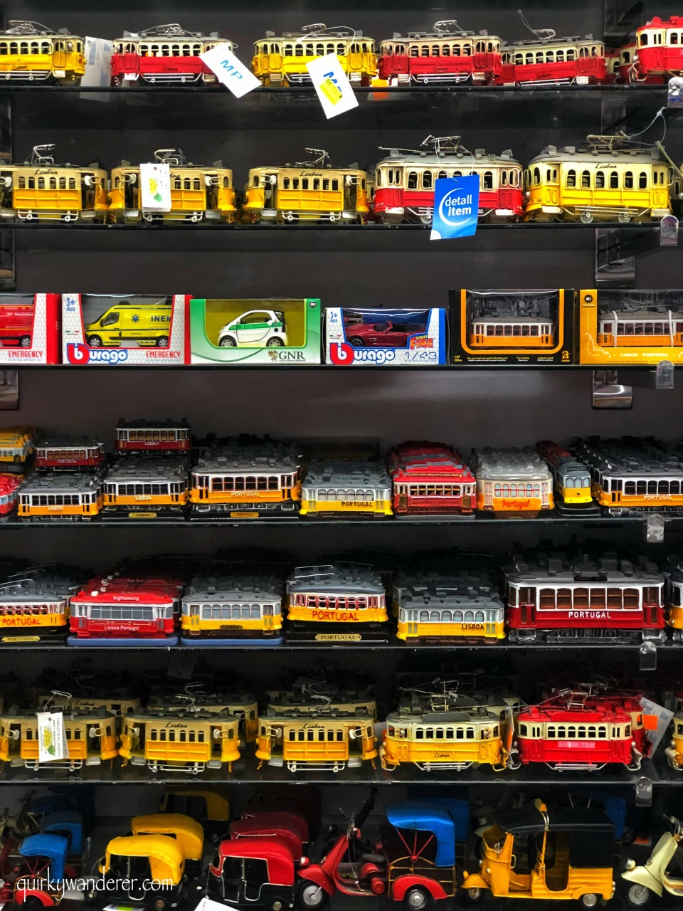 toy trams and vintage car models in Portugal